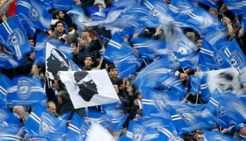 Bastia supporters cheer before their team's French League Cup final soccer match against Paris St Germain at the Stade de France stadium in Saint-Denis, near Paris, April 11, 2015. REUTERS/Charles Platiau - RTR4WXNH