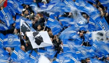 Bastia supporters cheer before their team's French League Cup final soccer match against Paris St Germain at the Stade de France stadium in Saint-Denis, near Paris, April 11, 2015. REUTERS/Charles Platiau - RTR4WXNH