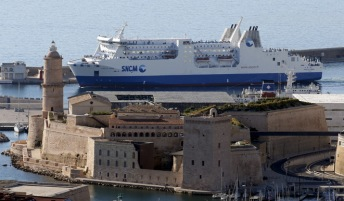 "The car ferry ""Paglia Orba"" operated by the SNCM (National Maritime Corsica-Mediterranean company) leaves the port of Marseille, France, June 26, 2015. REUTERS/Jean-Paul Pelissier - RTX1HZKQ"